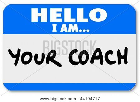 A namtag sticker with the words Hello I Am Your Coach to represent your life advisor, mentor, manager, leader or other person offering moral support or help