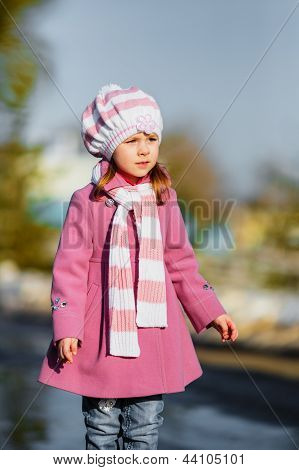 Young Girl Standing At Walkway
