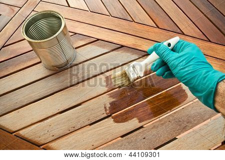 Staining wooden table.
