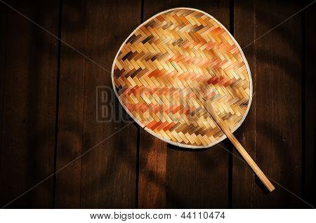bamboo fan on wall