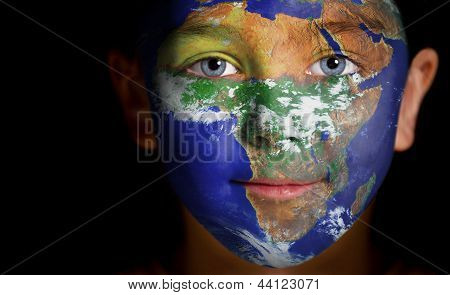 Portrait of a child with a painted Africa.