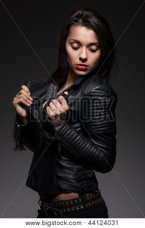 Glamorous woman in black jacket