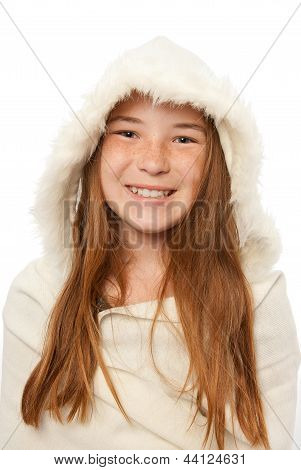 Young red headed child in a fur coat