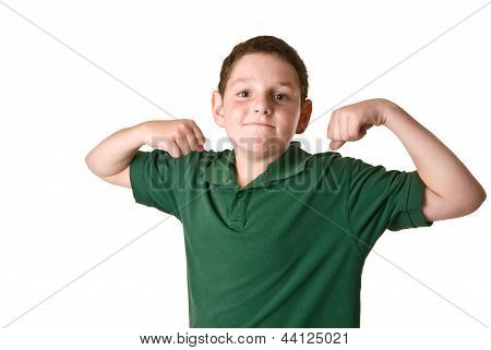 Young boy in a green polo shirt flexing