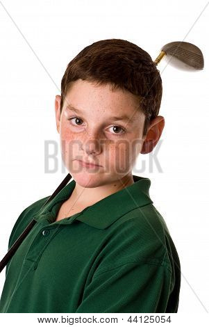 Young boy with golf club