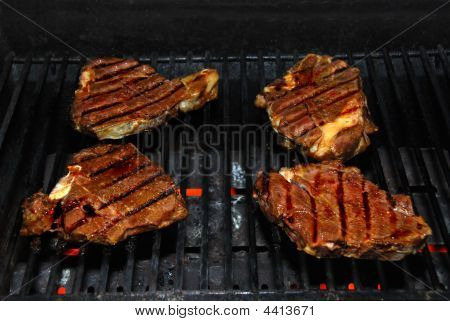Four Barbequed Steaks