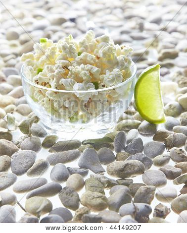 Bowl of popcorn and lime