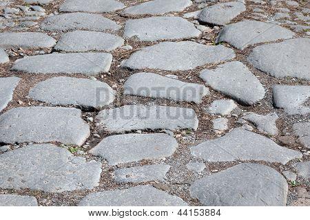 Detail Of Ancient Appian Way (appia Antica) Original Roman Age Cobblestone, Consisting Of Big Slabs.