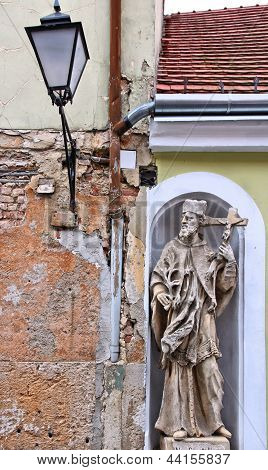 Koszeg Hungary - town in Vas county. Old town detail with statue of Saint John of Nepumuk. poster