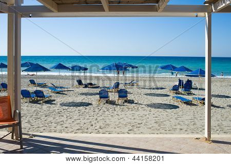 View Of Beach Chairs With Umbrellas