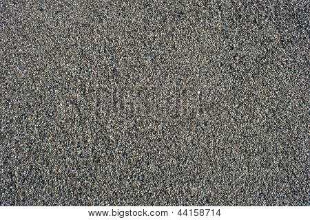 Damp And Grainy Sand Background