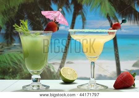 summer cocktails with fruit on the beach