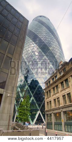 30 St Mary Axe also known as the erotic gherkin a 41-storey high round tapered sky-scraper was designed by Lord Foster the building was completed in December 2003 and opened on 28 April 2004 poster
