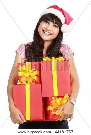 Christmas Woman Holding Gifts Wearing Santa Hat