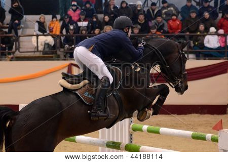 KAPOSVAR, HUNGARY - MARCH 24: Unidentified competitor jumps with his horse on the Masters Tournament International Jumping Competition, March 24, 2013 in Kaposvar, Hungary
