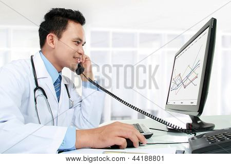 Doctor Working With His Computer