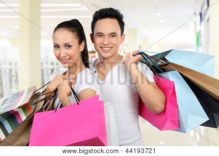 Man And Woman Carrying Shopping Bag