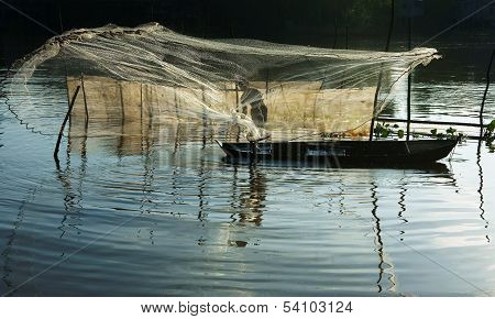 Beatutiful landcape with reflection of silhouette of fisherman cast a net on river surface water poster