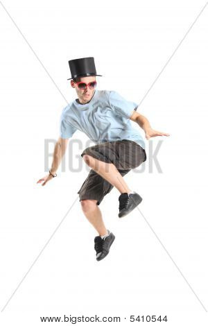 A Young Boy With Magic Hat In Jump