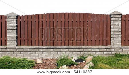 Fence Fragment From Planks And Bricks