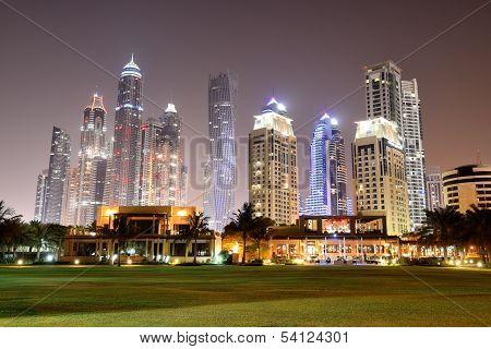 Beach night illumination of the luxury hotel Dubai UAE poster