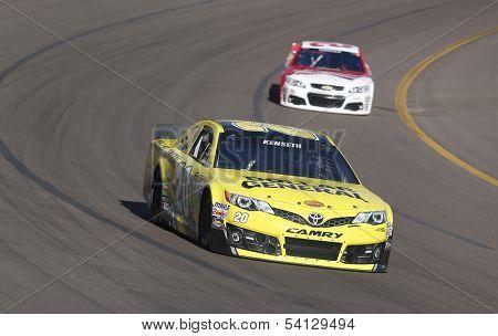 Avondale, AZ - Nov 09, 2013:  Matt Kenseth (20) brings his race car through the turns during the AdvoCare 500 race at the Phoenix International Raceway in Avondale, AZ on Nov 9, 2013.