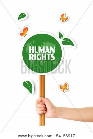 Hand Holding Green World Human Rights Sign