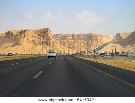 Road trough the desert Riyadh-Makkah (Mecca) highway in Saudi Arabia                                poster