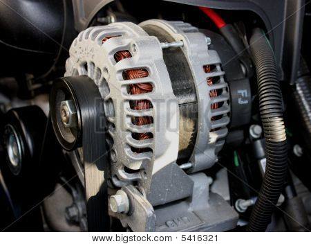 Alternator on an automobile.