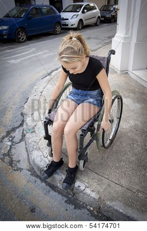 Person In Wheelchair Trying To Cross The Road