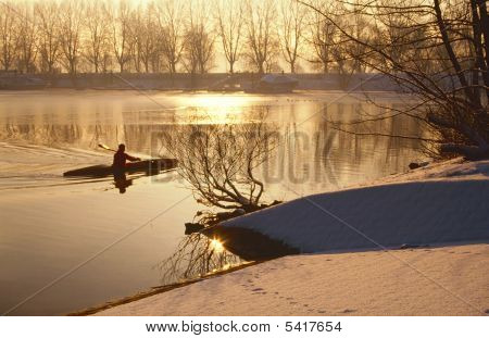 Oarsman On Ice Cold Lake