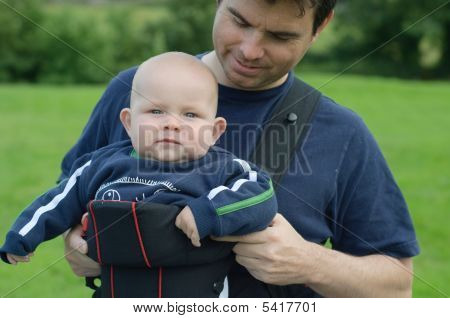 Father With His Baby Son In Carrier