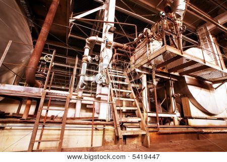 Pipes, Tubes, Machinery And Steam Turbine At A Old Power Plant