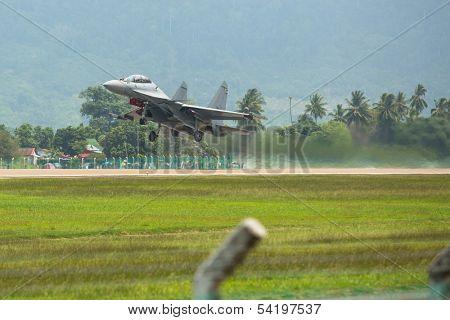 LANGKAWI, MALAYSIA - MAR 26: Su-30MKM (Sukhoi, NATO reporting name: Flanker-C) performing during on LIMA13 Langkawi International Maritime & Aerospace Exhibition on Mar 26, 2013 in Langkawi, Malaysia.