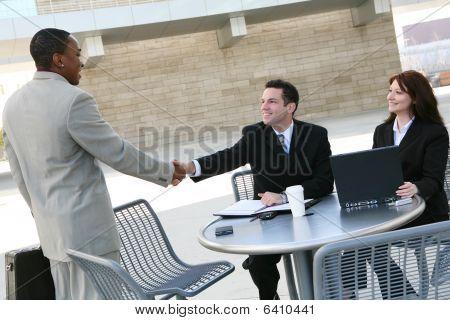 Business Team Hanshake At Office