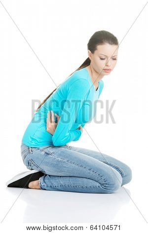 Young woman with stomach issues,isolated on white