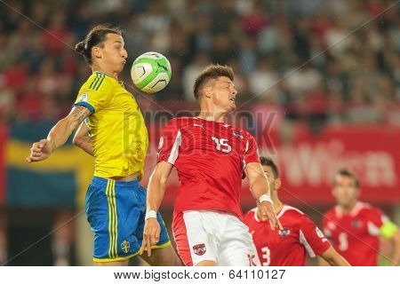 VIENNA,  AUSTRIA - JUNE  7 Sebastian Proedl (#15 Austria) and Zlatan Ibrahimovic (#10 Sweden) fight for the ball during the world cup qualifier game on June 7, 2013 in Vienna, Austria.