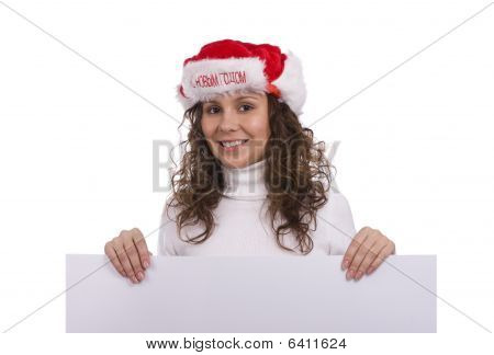Woman In Christmas Cap Holding Blank Informational