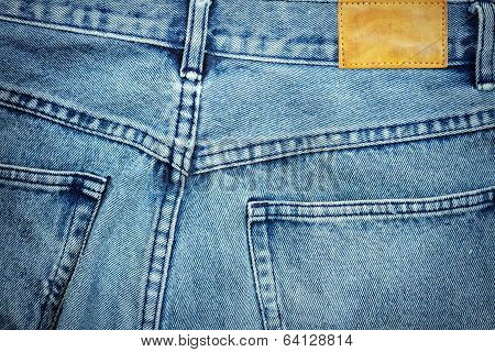 Blank leather jeans label sewed on a blue jeans. poster