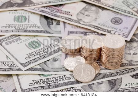 Gold Coins On Dollar Bills