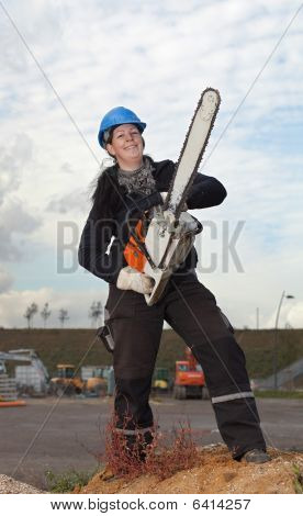 Female Worker With Chainsaw