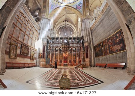 JERUSALEM, ISRAEL - MARCH 9, 2012: Church of the Holy Sepulcher in Jerusalem. Hall is beautifully lit sunlight through windows in the domed ceiling and lamps