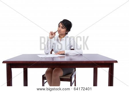 Businesswoman thinking at her desk