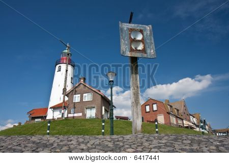 Seafront With The Lighthouse And An  Old Foghorn Of The Fishing Village Urk, The Netherlands