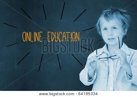 The word online education against schoolboy and blackboard