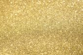 Gold Glitter with Selective Focus 2/3 way down from top of frame. poster