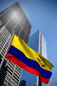 Colombia national flag against low angle view of skyscrapers poster