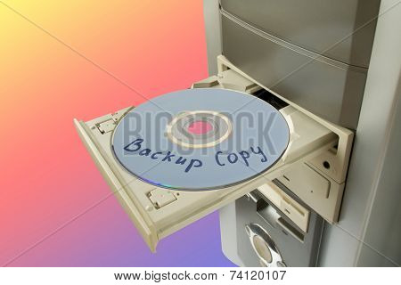 Disc Backup copy in tray, rainbow background