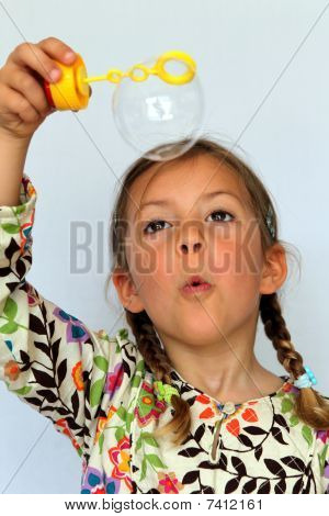 Girl looking at bubble