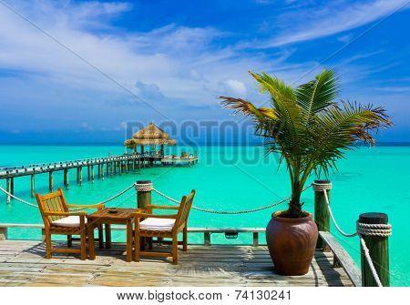 Cafe on the beach, ocean and sky